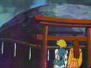 Seiji and Nasutei standing by a rock.